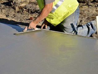 A concrete contractor pouring concrete for the foundation for a new home in Moore, OK
